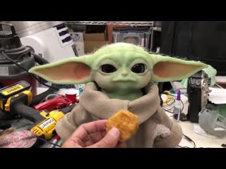 This custom-made Baby Yoda animatronic deserves all the chicky chicky nuggs